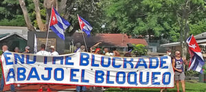 Caravans, rallies and meetings took place in U.S., Canada, U.K. and elsewhere Aug. 29, protesting Washington's economic war against Cuba. Above, protesters at Toussaint L'Ouverture park in Miami donated to Haiti earthquake relief.