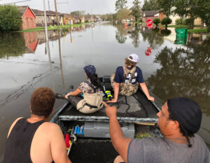 Volunteers organized by Cajun Navy group travel through flooded LaPlace, Louisiana, Sept. 2. Groups aided people, distributed food and supplies, showing power of working-class solidarity.