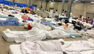 Inhumane conditions in warehouse in Independence, Louisiana, where 850 nursing home residents were sent after hurricane. It took days for the state to intervene, while 7 people died.