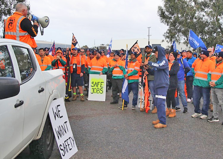 """Toll Group truck drivers strike to defend their jobs, as thousands more truckers plan strike action. Union battle takes place as Australian military withdraws from Afghanistan, and soldiers, police patrol in Sydney to enforce workers' """"compliance"""" with COVID quarantines."""