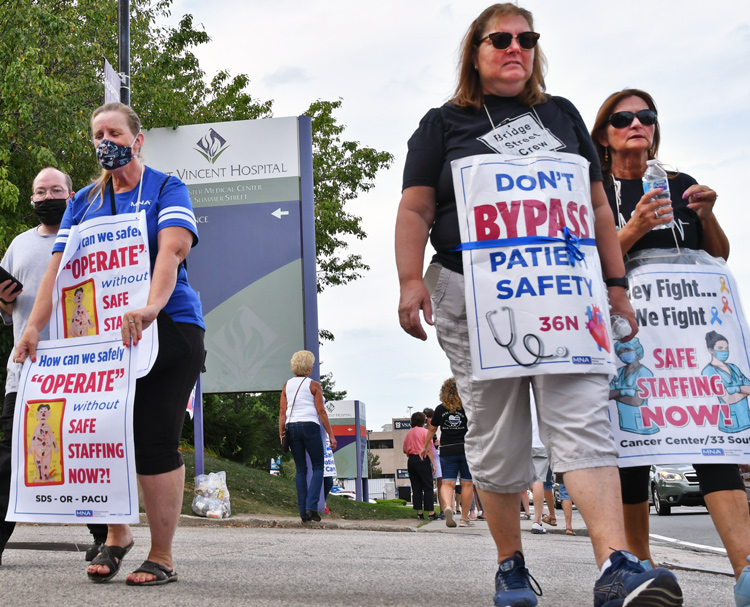 Fighting for safe staffing levels for themselves and patients, nurses picket St. Vincent Hospital in Worcester, Massachusetts, Aug. 16. Six-month strike is longest nurses strike in 15 years.