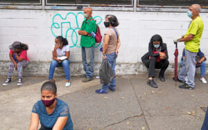 Venezuelans wait in line in Caracas for COVID vaccine Sept. 8. Washington's punishing sanctions have disrupted vaccination, with only 11% of the population fully dosed. In the coming months, revolutionary Cuba is organizing to supply 12 million doses of its Abdala vaccine.
