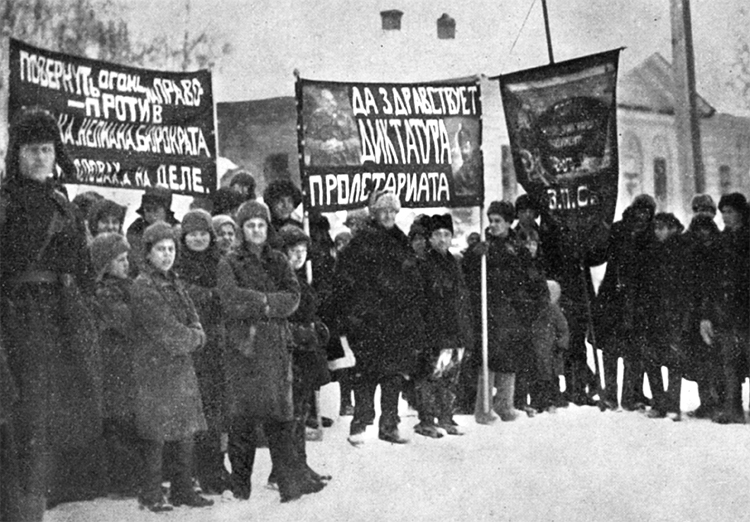 """1928 protest at exile colony in Siberia, Russia. Center banner with portraits of V.I. Lenin and Leon Trotsky says, """"Long live dictatorship of proletariat."""" Fight against Stalinist bureaucracy was to reestablish proletarian internationalism of 1917 Bolshevik Revolution under Lenin."""