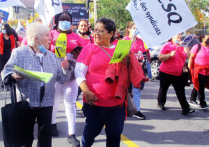 Beverly Bernardo, left, Communist League candidate for mayor of Montreal, marches with day care workers' union in Montreal Oct. 12 during two-day strike over wages, working conditions.