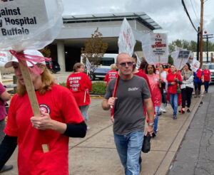 Striking health care workers picket at Mercy Hospital in Buffalo, New York, Oct. 12, on day 12 of their strike for safe staffing, higher wages, especially for lowest-paid workers.