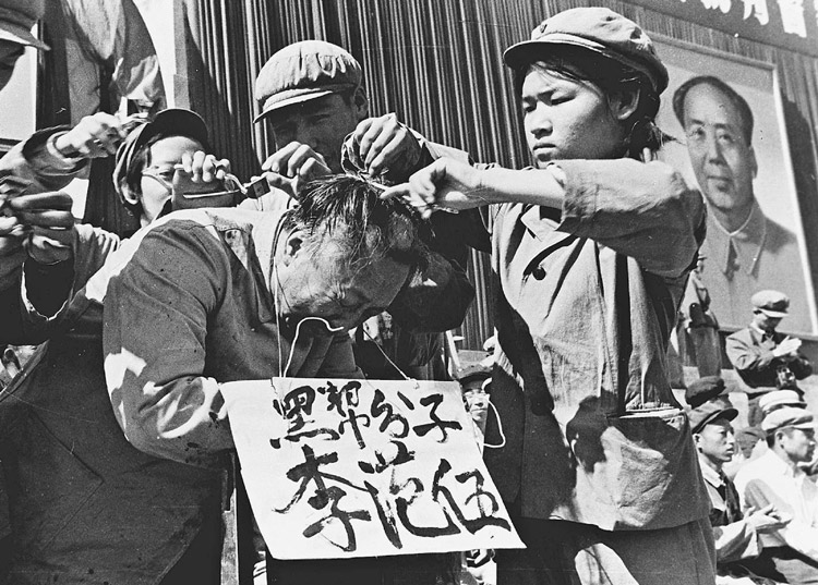 """Red Guards, instigated by Mao Zedong, in poster on right, publicly humiliate official during 1966-76 anti-working-class Cultural Revolution in China. Fidel Castro said Mao and the Chinese Communist Party's counterrevolutionary policies led Beijing to an alliance with U.S. imperialism and """"brutal attacks"""" against the heroic peoples of Vietnam, Angola and Cuba."""
