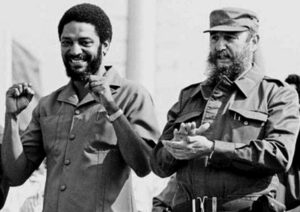 """Maurice Bishop, left, leader of Grenada Revolution, with Fidel Castro at May Day 1980 rally in Cuba. Bishop was """"a true revolutionary,"""" Castro said. But """"hyenas emerged from the revolutionary ranks"""" there, """"destroyed the revolution and opened the door to imperialist aggression."""""""