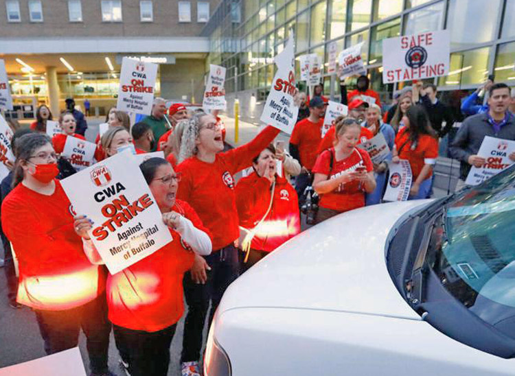 Strikers at Mercy Hospital in Buffalo, New York, face off against van carrying strikebreakers. Some 2,000 union members struck Oct. 1 over staffing shortages, unsafe working conditions.