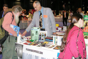 Supporters of the Socialist Workers Party organize production and distribution of Pathfinder books by party leaders and other revolutionary fighters. Above, Tim Craine staffs Pathfinder Press table at New England Booksellers Association trade show in Boston in 2004.