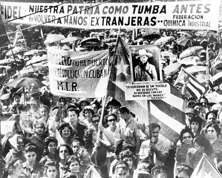 """Rally in Havana in 1960 backs revolutionary government's nationalization of imperialist- owned properties in Cuba. Workers mobilized to """"intervene"""" to gain control of factories, part of Cuban toilers acquiring class consciousness, making socialist revolution their own."""
